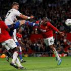 Manchester United's Ashley Young (R) heads to score against FC Basel during their Champions...