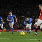 Manchester United's Dimitar Berbatov (R) shoots to score a penalty for his hat-trick against...