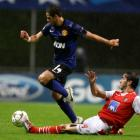 Manchester United's Javier Hernandez (L) is challenged by Braga's Nuno Andre Coelho during their...
