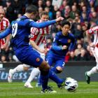 Manchester United's Robin van Persie shoots to score a penalty against Stoke City during their...
