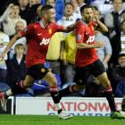 Manchester United's Ryan Giggs (R) celebrates scoring with Federico Macheda during their English...