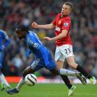 Manchester United's Tom Cleverley (R) challenges Chelsea's Victor Moses during their FA Cup...