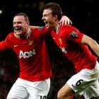 Manchester United's Wayne Rooney (L) celebrates his goal against Fulham with Jonny Evans during...