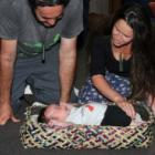 Marcus Tuwairua (33) and Hana Park (31), of Waitati, sing to their 9-week-old son Rokomai...