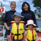 Marie Attridge (left) and Claire George, of Lakes Leisure, help Max (6) and Annika (4) Simpson...