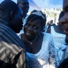 Marie Neslene Leon, center, is congratulated by friends and relatives after her wedding in front...