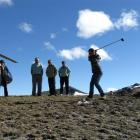 Mark Cameron tries on his best swing at the top of the Remarkables last Saturday, while the rest...