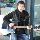 "Mark MacDonald, of Maheno, was busking yesterday in the Gold Guitars ""Freeze Ya Bits Off"" busking..."