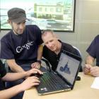 Mark McKenzie (left) learns how to render a building in 3D that could be uploaded to Google Earth...