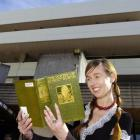 Marketing co-ordinator Liz Knowles holds the library's first book, Volume I of The Poetry of...