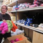 Marnie Kelly with some skeins in the  factory.