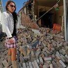 Marsha Witehira looks into the ruins of her bedroom as she contemplates a very close encounter...