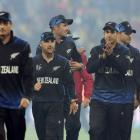 Martin Guptill leads New Zealand off the field after their win over the West Indies in in...