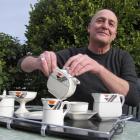 Martin McPherson makes a cup of tea with his Art Deco empire ware tea set as he settles into his...