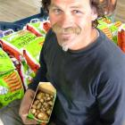 Marty Quennell has dug the first of the season's new potatoes at his Brydone Growers market...