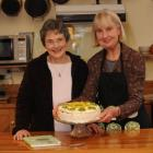 Mary Browne and Helen Leach show off their fail-safe pavlova. Photo by Peter McIntosh.
