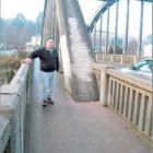 Mataura Community Board chairman Bill Lee stands beside the Mataura Bridge last year after it had...