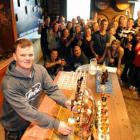 Mathew Beard (27), of Sydney, learns to pour a beer while his Contiki tour party group samples...