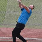 Matthew Bloxham, of Auckland, in action in the throws battery pentathlon at the Caledonian Ground...