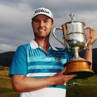 Matthew Griffin poses with the trophy after his victory in the New Zealand Open. Photo Getty Images