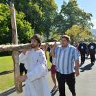 Max Whitaker leads the North Dunedin Walk of the Cross through the Dunedin Botanic Garden...