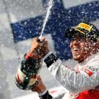 McLaren driver Lewis Hamilton of Britain celebrates after winning the Hungarian F1 Grand Prix at...