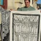 Damien McNamara holds one of his woodcuts outside the Connell and Clowes building in Tyne St....