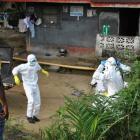 Medical staff gather at a health facility near the Liberia-Sierra Leone border in western Liberia...