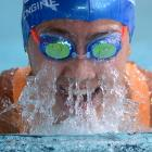Meg Sycamore takes a breath on her way to winning the girls 13-14 years 100m breaststroke during...