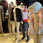 Megan Tregilgas, from Sydney, dresses mannequins for the opening of the new Levi's shop in the...