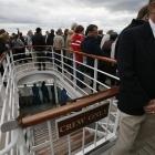 Members of the crew are seen at the deck below partying guests as the Titanic Memorial Cruise...