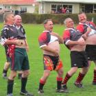 Members of the Eastern Districts Old Devils side attempt to intimidate their opponents at the...