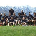 Members of the Kiwis rugby league team assemble for a photo in front of a snowy backdrop after...