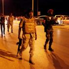 Members of the Libyan army head to one of the headquarters of the Islamist Ansar al-Sharia...