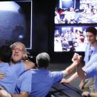 Members of the Mars Science Laboratory (MSL) team celebrate as the first images are shown on...