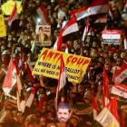 Members of the Muslim Brotherhood and supporters of deposed Egyptian President Mohamed Mursi wave...