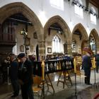 Members of the public view the coffin of King Richard III in Leicester Cathedral, central England...