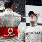 Mercedes driver Nico Rosberg of Germany is sprayed with champagne during the podium ceremony...
