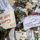 Messages and flowers are placed at the beach of the Imperial Marhaba resort, which was attacked...