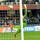 Mexico goalie Jose Gonzalez dives but cannot save a goal against Serbia.
