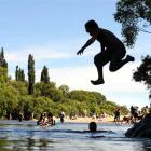 Micah Wharerimu (11), of Dunedin, was among the hundreds of bathers taking the plunge in the...
