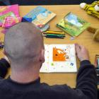 Michael, an inmate at the Otago Corrections Facility, adds the finishing touches to a story he...