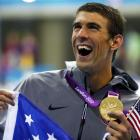 Michael Phelps holds the gold medal he won as part of the men's 4x200m freestyle relay team at...