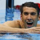 Michael Phelps of the U.S. reacts after winning his men's 200m butterfly semi-final at the London...