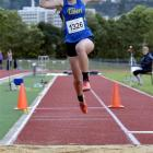 Mikayla Thorn shows the form that won her the under-18 triple jump at the twilight meeting at the...