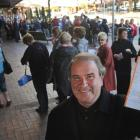 Mike Bird, of Dunedin, with his Elton John concert booking ticket, in front of the queue of...
