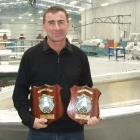 Milton boat-builder Steve McLay holds the trophies for best aluminium fishing boat open class and...