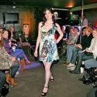 Model Gabrielle Coppola shows a dress from Nine at the charity fashion show at Subculture last...
