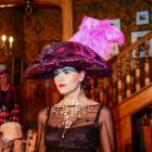 Models parade a century of hat fashion at the ''Hats on Royal'' fashion show held at  Olveston on...