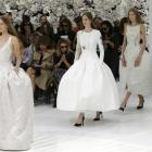Models present creations by Belgian designer Raf Simons as part of his Haute Couture Fall/Winter...